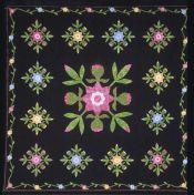 Black quilt with flowers
